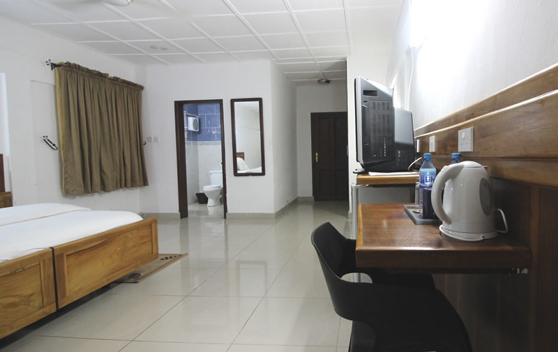 It has 1 double bed, a tea/coffee facility, bottled water, refrigerator and a minibar
